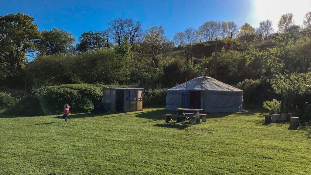 yurt on grass with blue sky