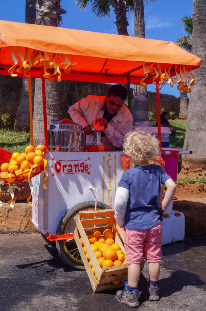 boy buying orange juice