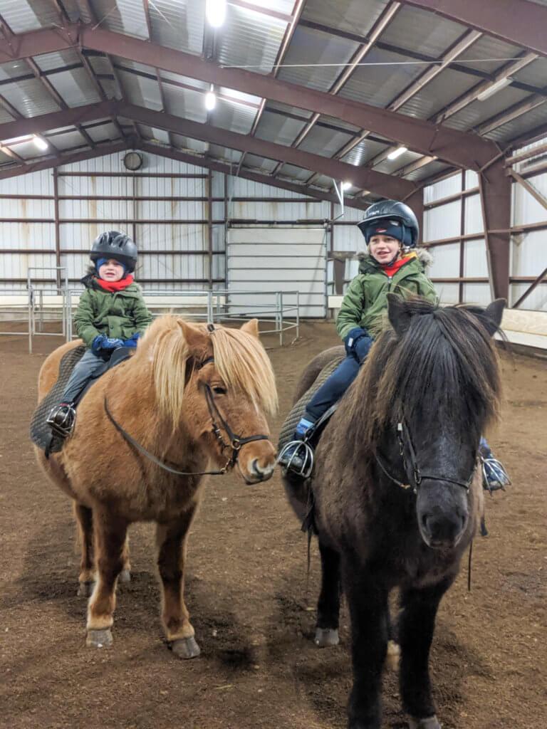 boys having a horse riding lesson at Gauksmýri Lodge
