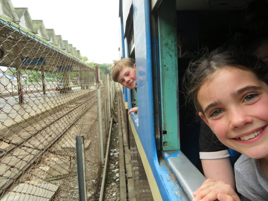 riding the train in Yangon with kids