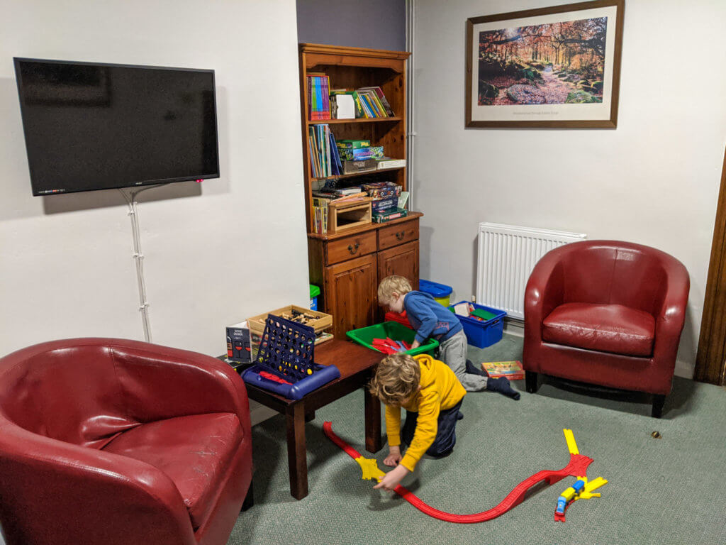 playing with train set in YHA Eyam lounge