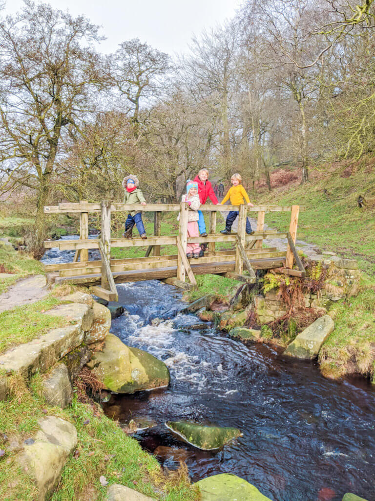 kids on bridge over river in Peak District